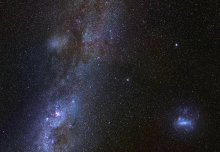 A galaxy a third the size of our own, but extremely faint, has been observed orbiting around the Milky Way.