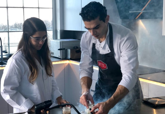 Jozef Youssef and Katerina Stavra cook in a kitchen