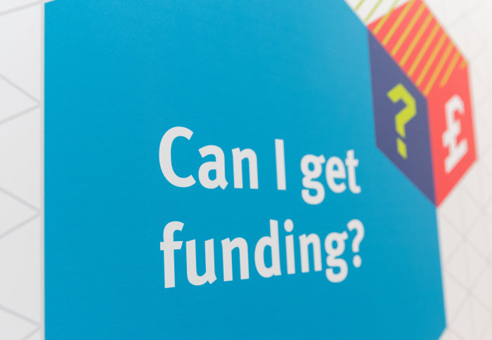 A poster asking about funding