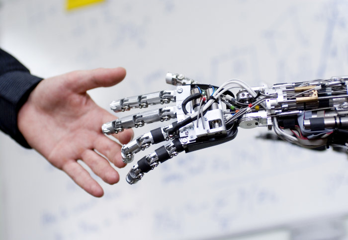 Robot and human hand connecting.