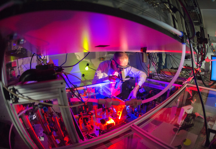 Man in protective gear working in ultrafast molecular imaging lab