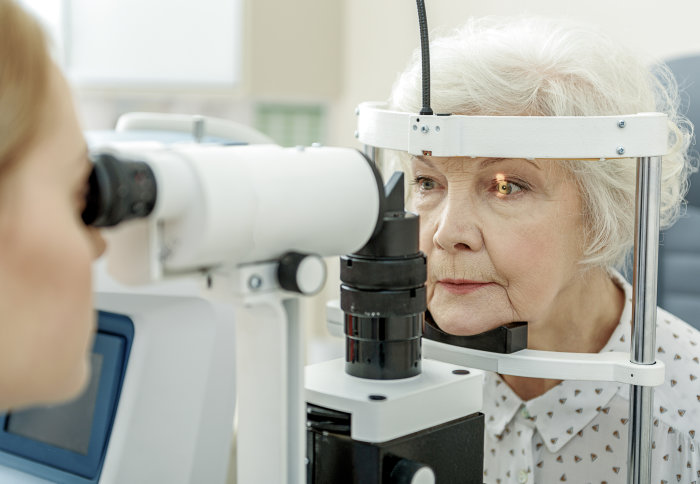 An elderly woman getting an eye test