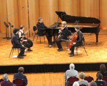 A pianist and string quartet perform
