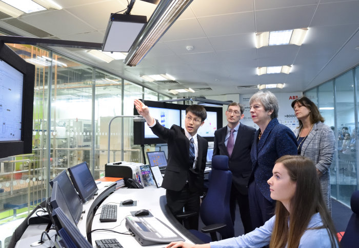 Prime Minister Theresa May and Energy Minister Claire Perry with Dr Colin Hale and students