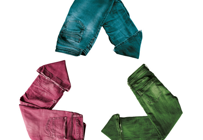 Trousers arranged in the shape of a recycled symbol