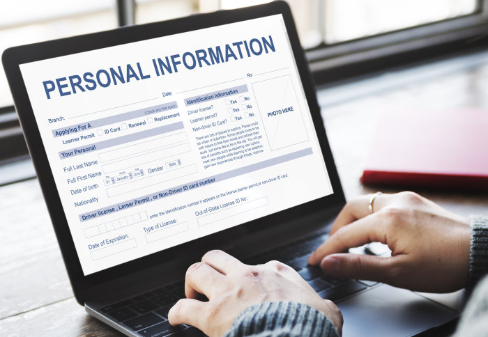 Photo of woman typing on laptop that says PERSONAL INFORMATION at the top