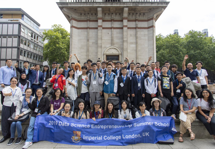 Group photo of students attending the Data Science Entrepreneurship Summer School 2019 in front of the Queen Tower