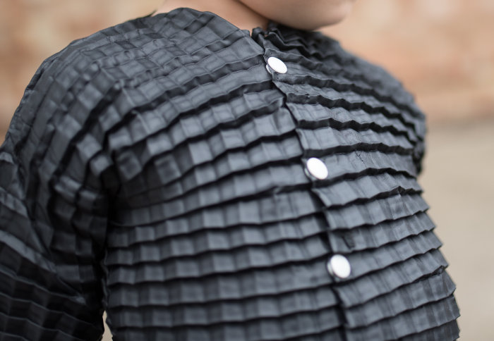 An expandable shirt made for children by Imperial startup Petit Pli