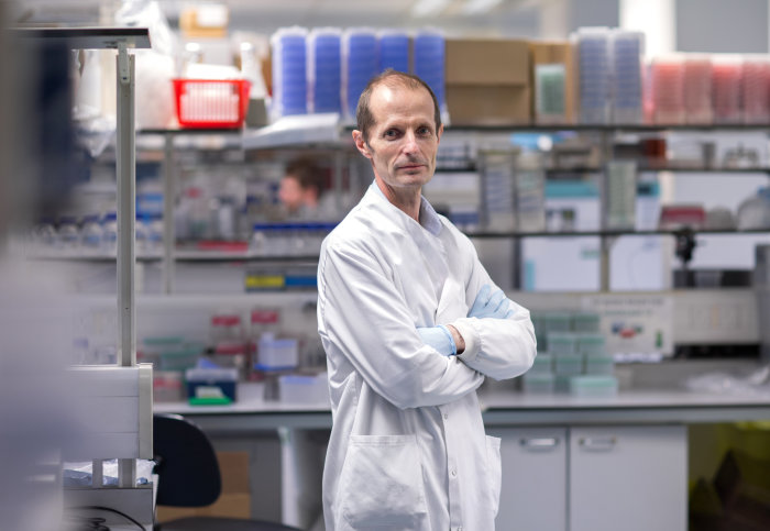 Professor Robin Shattock, from the Department of Infectious Disease, standing in his laboratory