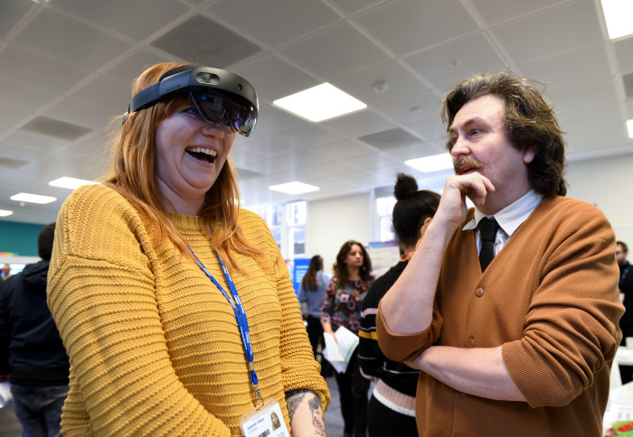 Man and woman try out Microsoft HoloLens2 augmented reality headset
