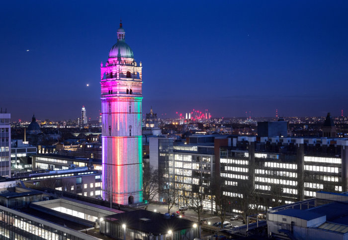 Queen's Tower lit up in rainbow colours during the evening