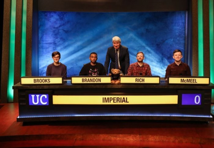 Students on University Challenge table with Jeremy Paxman