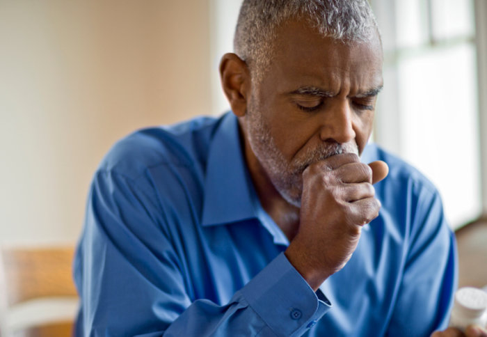 Older adult man coughing