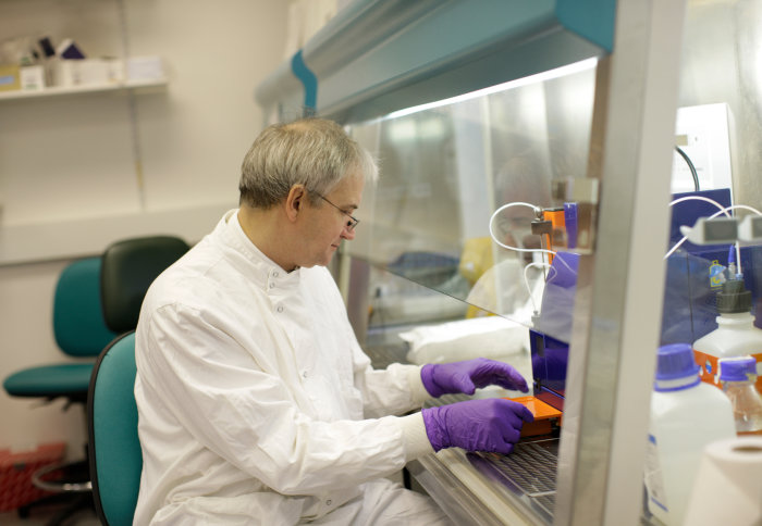 Peter Openshaw working with chemicals in a fume hood