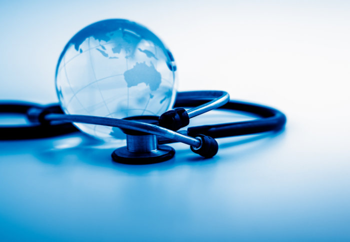 A stethoscope around a globe