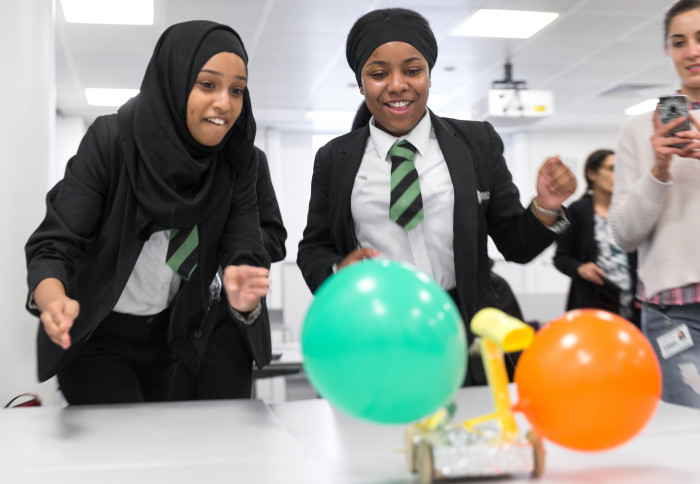 Two teenage school girls participate in an engineering workshop