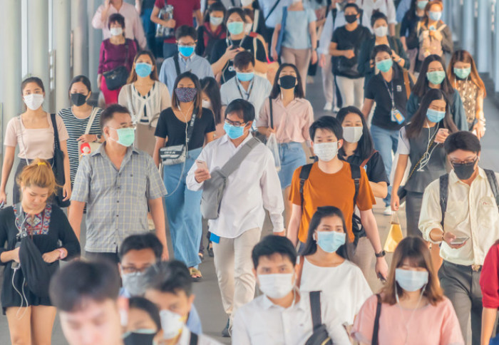Crowd of people wearing masks
