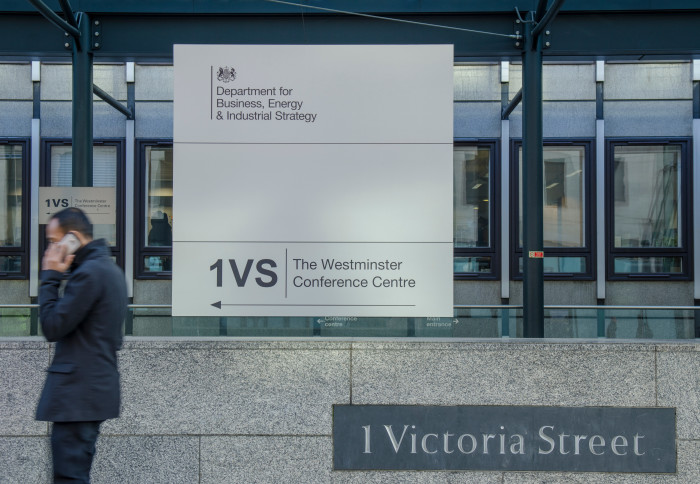 A man walks past the Department for Business, Energy and Industrial Strategy on 1 Victoria Street