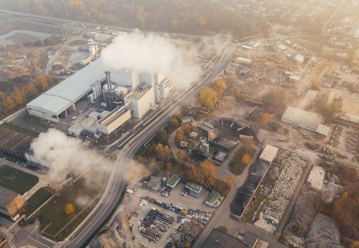 Aerial view of industrial buildings and smoke