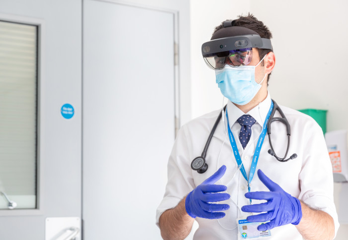 Dr Louis Koiza wears the HoloLens on site at St Mary's Hospital