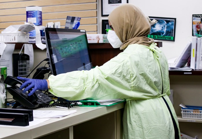 A woman working in personal protective equipment