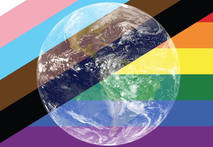 Image of the Earth overlayed on the LGBT+ Pride flag that incorporates the pale blue, pink, brown and black stripes representing trans and minority ethnic inclusion