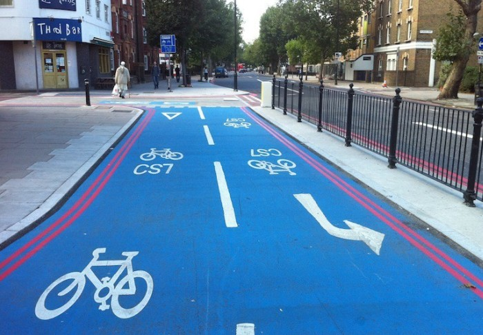 A blue cycle lane on a street