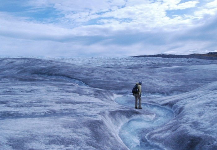 An illustration of a melting ice cap with someone walking on it