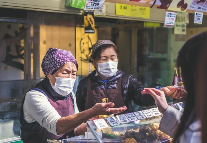 Women in Japan wearing face masks