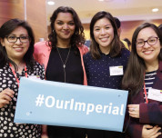 Students at international scholars' event holding a board that reads #ourimperial