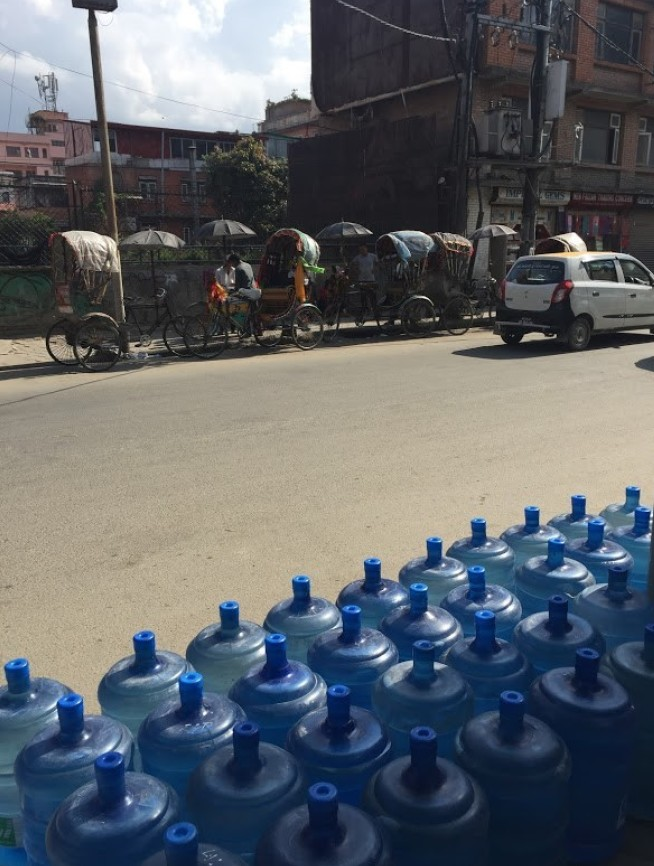 Barrels of drinking water lined up in the streets of Kathmandu