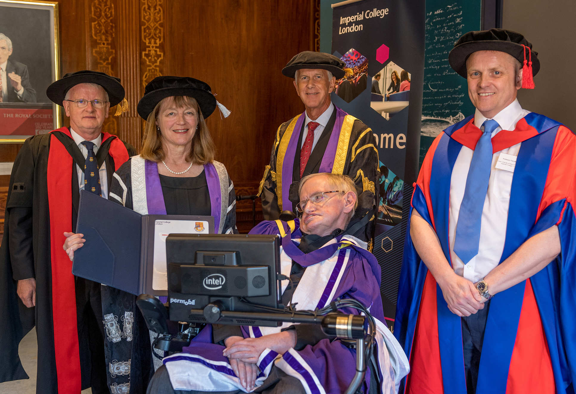 Stephen Hawking in robes in with Imperial dignitaries