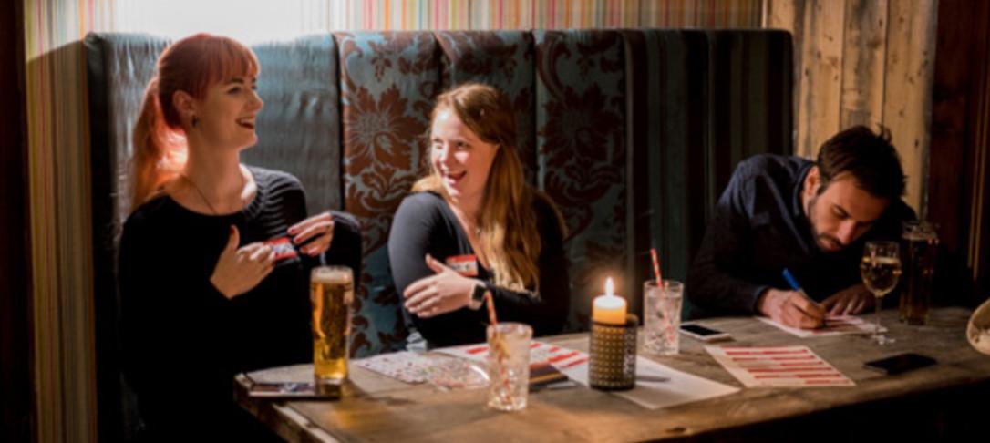 Friends playing a pub quiz