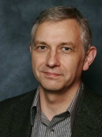 Headshot of Dr Adrian Butler