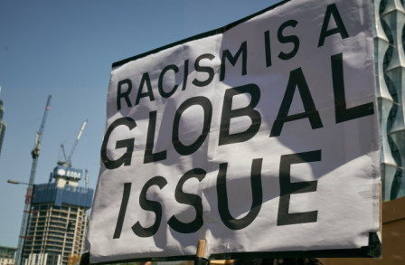 Banner saying 'racisim is a global issue'
