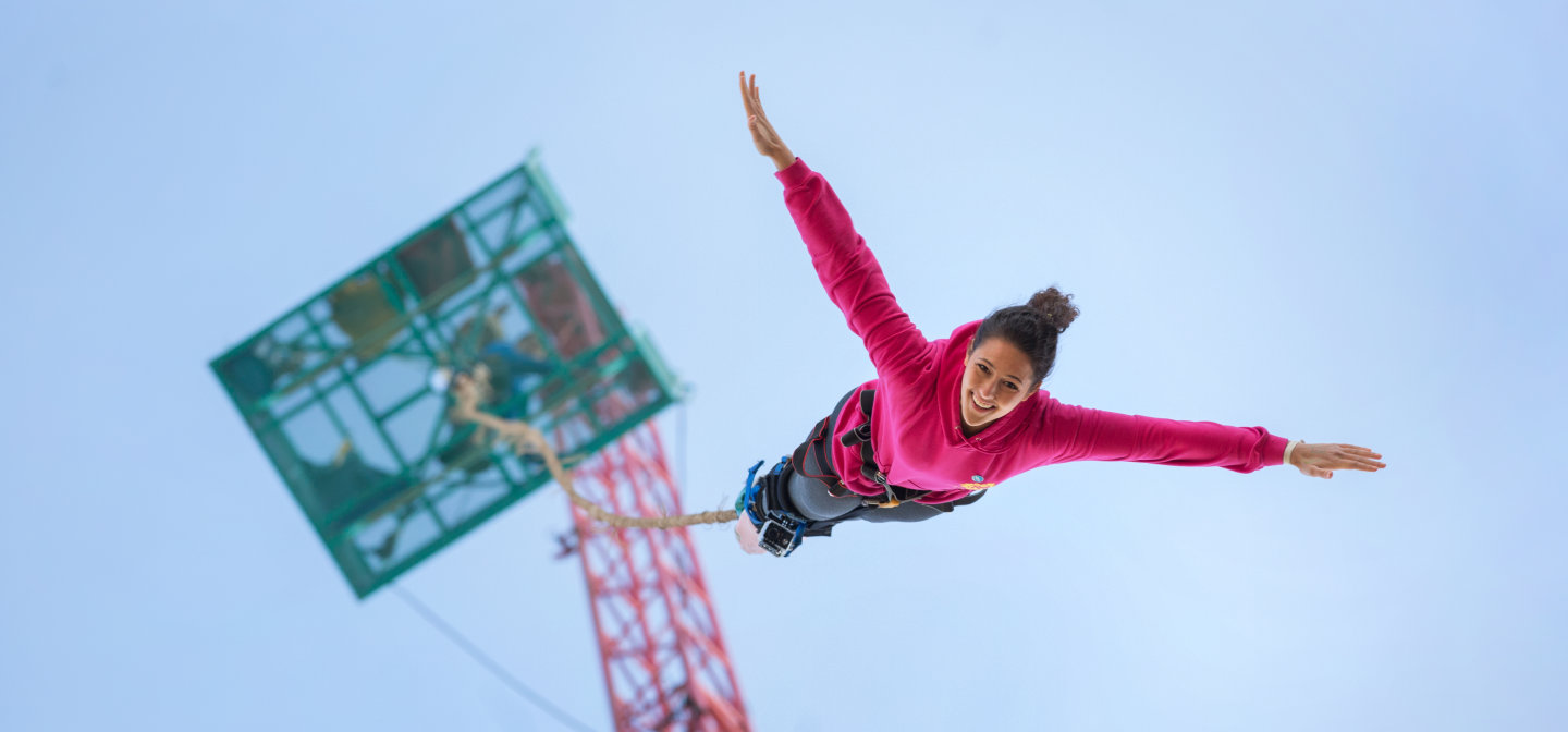 Girl bungee jumping