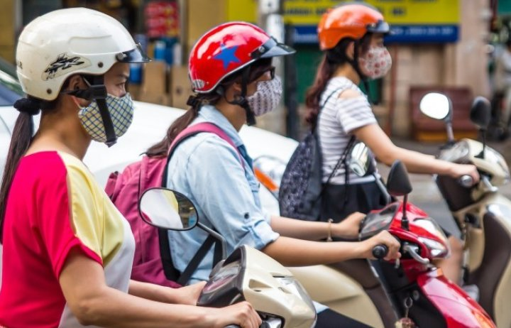 People on scooters wearing face masks