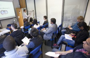 Students gather for a research seminar development session