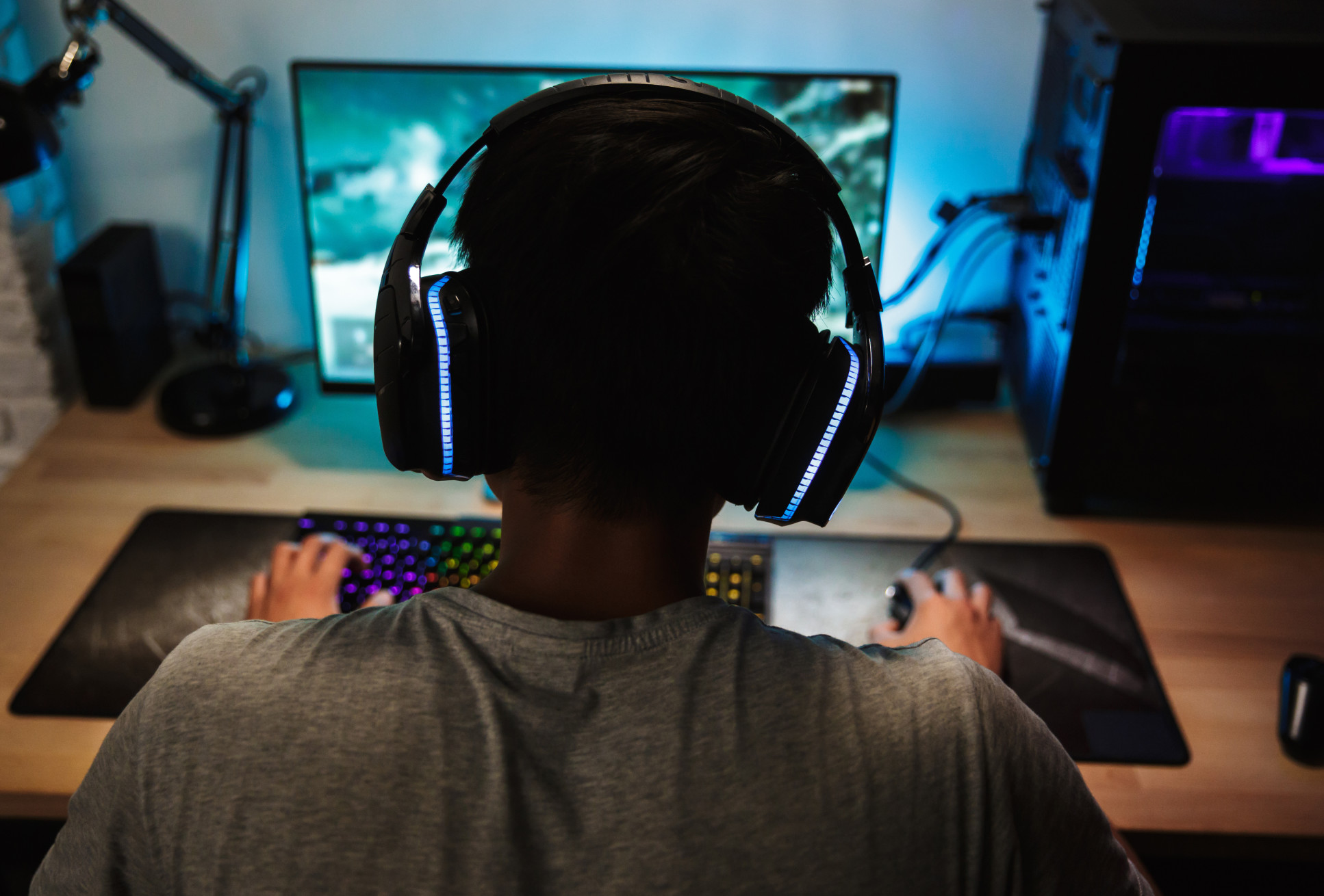 Teenager playing videogame
