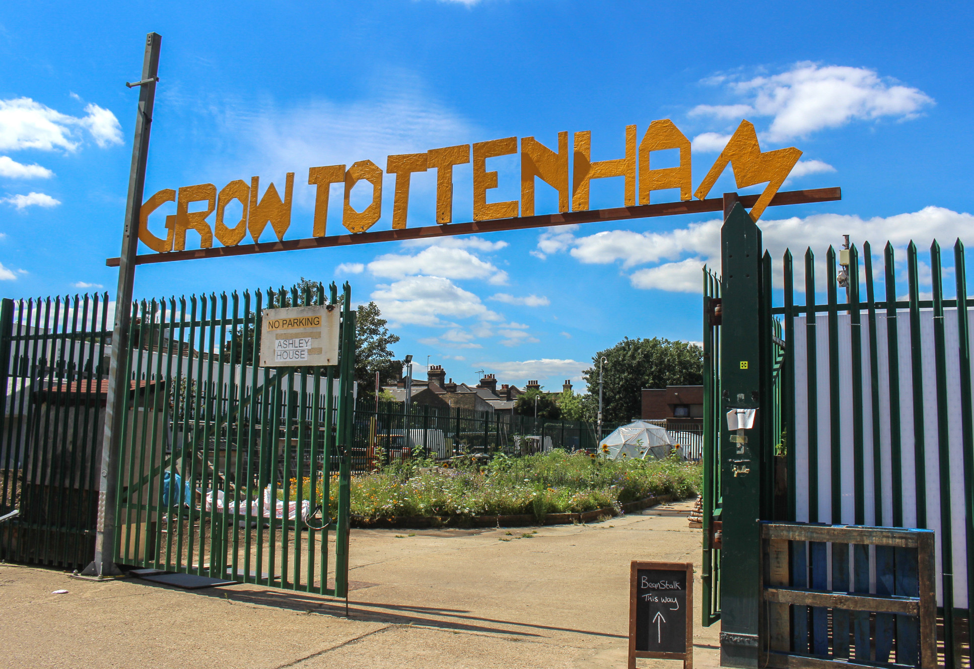 Sign over a fence that read 'Grow Tottenham'