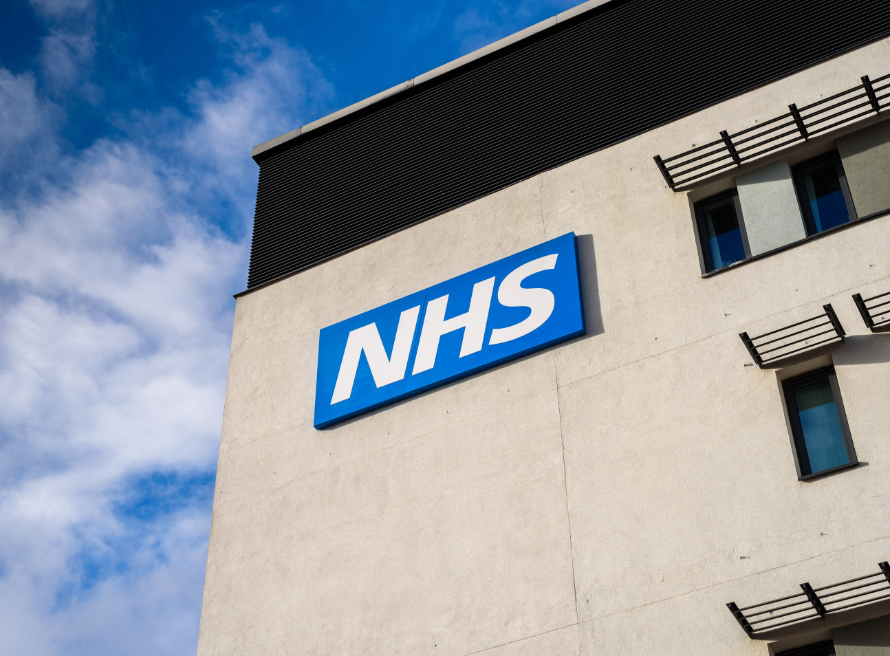 NHS logo on a hospital building