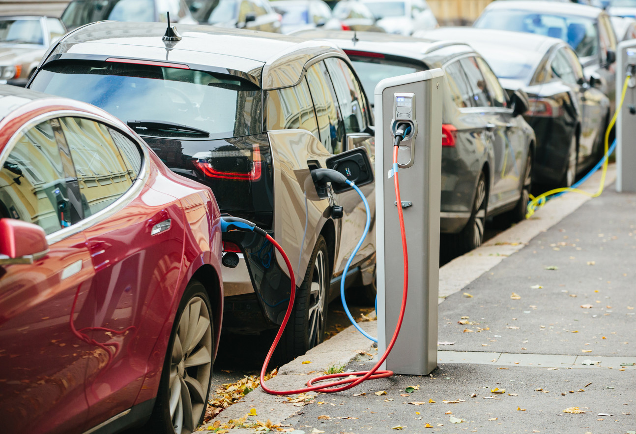 Electric cars charging on a street