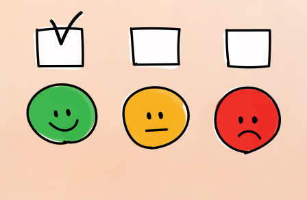 Face emojis representing happy, sad, and no reatction with tick boxes above each face