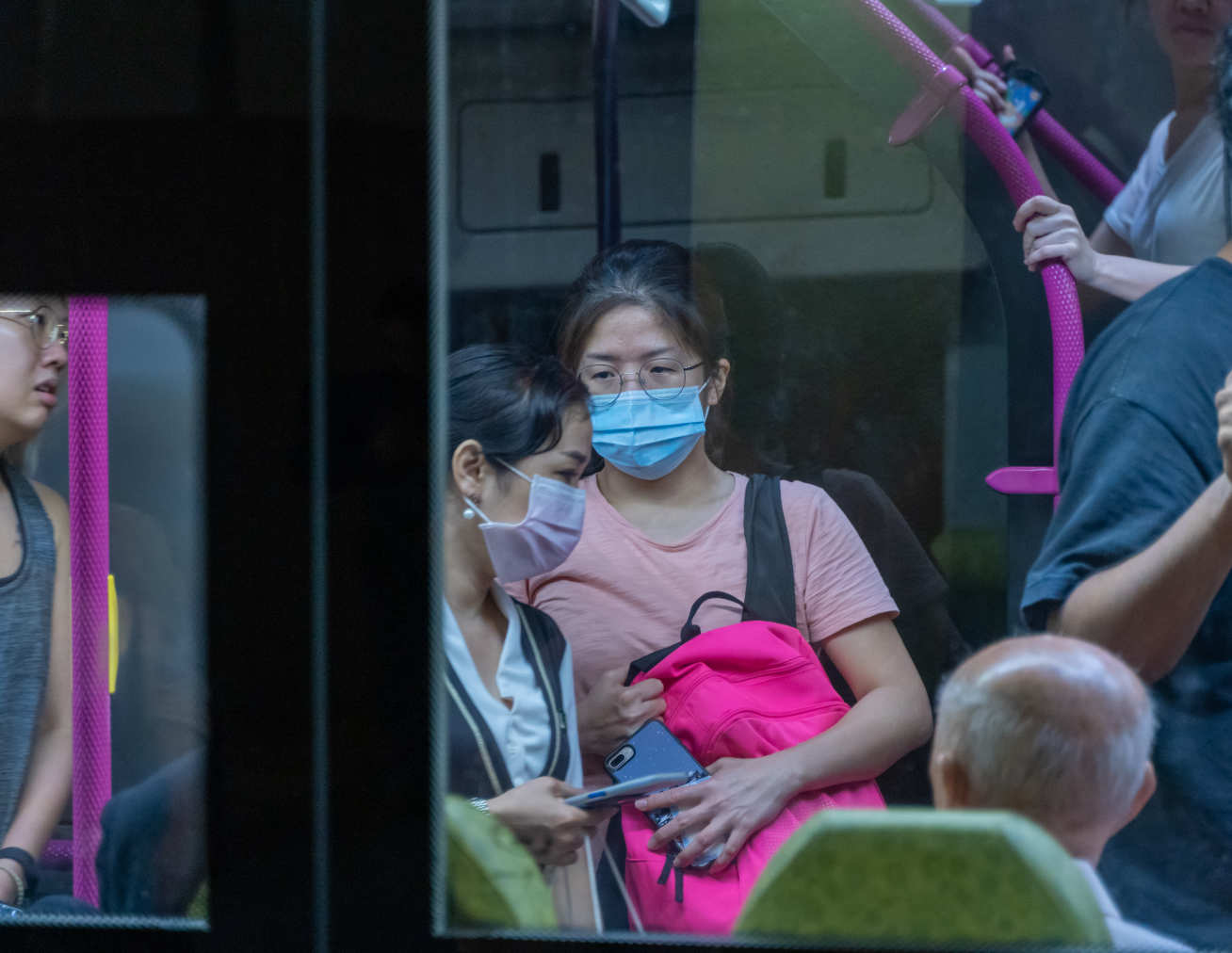 people wearing masks in the bus. social distancing