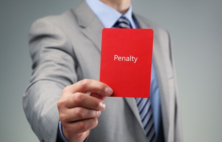 Man holding a penalty card