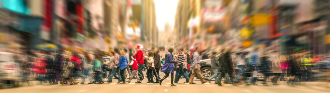 Crowd of people crossing a road Credit: shutterstock