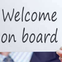 Man holding welcome on board sign