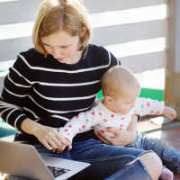 Parent with child and laptop