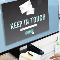 Keep in touch sign on laptop
