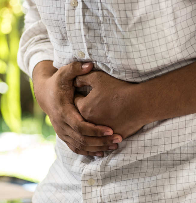 Photo of man clutching tummy in pain